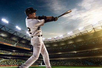 """Así Torres, en una imagen delante de un aparato de televisión con imágenes del juego, publicó las etiquetas: """"YoSoyBoricua #PaQueTuLoSepas #TeamRubio #LosNuestros #CapsOn #PR #PuertoRico #BaseBall ??#Pelota #VamoArriba #EsooEhh #EstosSonLosMios"""". (Dreamstime)"""