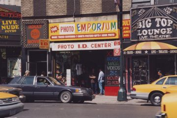Robert Iulo  [The Photo Emporium / Big Top Lounge, 671 Eighth Avenue], 1998 Chromogenic development print Museum of the City of New York. Gift of Robert Iulo, 2017.17.49